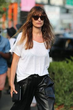 Relaxed leather pants, simple tee. Caroline de Maigret.