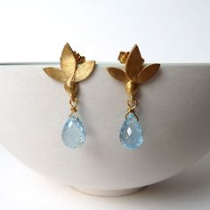 Ami Leaf Stud Earrings made from sterling silver with 18ct yellow gold plate and semi precious gemstone drops - topaz