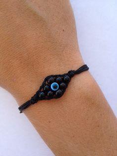 Evil Eye Shaped Black Beaded Bracelet by IzouBijoux on Etsy, €10.00