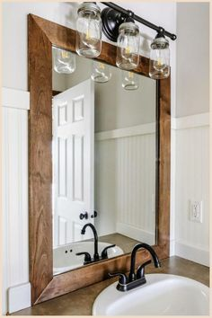 How to Add a DIY Wood Frame to a Bathroom Mirror - This DIY is as easy as it gets for decor ideas for the home. Follow the step by step tutorial to see how to decorate your bathroom mirror with a wood frame. Love these budget friendly decor ideas for the home! #joyfullygrowingblog #homedecor #diydecor #decorideas Wood Framed Bathroom Mirrors, Diy Mirror, Mirror Ideas, Wood Mirror, Bathroom Mirror Design, Bois Diy, Rustic Industrial Decor, Industrial Decorating, Rustic Frames
