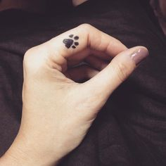 paw print on finger - this is my favorite [small] tattoos