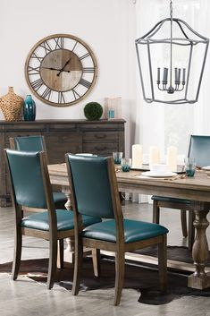 This modern dining room features beautiful wood tones and vibrant teal hues. Featured products: Banff Dining Chairs, Aspen Dining Table, Calistoga Server.