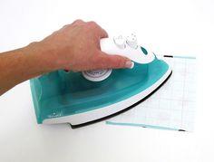 Impermeabilização de tecido com papel autocolante utilizado para forrar livros! Genial
