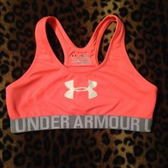 Under armour sports bra Brand new bought it on here with the tags still on it! Never worn to work out in or anything I just tried it on and it's a little too snug for me very cute though and really bright! Under Armour Intimates & Sleepwear