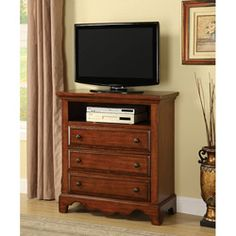 @Overstock - Material: Solid wood, wood veneer  Wood finish: Cherry oak  Media chest features a wave-front silhouette that is perfectly scaled to support a televisionhttp://www.overstock.com/Home-Garden/Coast-Cherry-Oak-Finish-Media-Chest-Cabinet/6253738/product.html?CID=214117 $467.99