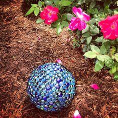 thrifted bowling ball + dollar store gems = DIY garden ball  Instagram @ keepinitthrifty