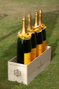 A ring toss game made from wine or champagne bottles. How fun - money spinner