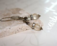 Really like th elook of these—Czech glass champagne earrings