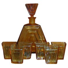 Beautiful antique seven-piece Art Deco drink set including a fabulous amber glass decanteur and six matching liquer glasses.