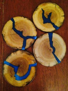 coasters with blue glowing resin inlays Wood coasters with blue glowing resin inlays. Would love to have these for my desk!Wood coasters with blue glowing resin inlays. Would love to have these for my desk! Diy Resin Crafts, Wood Crafts, Kids Crafts, Diy And Crafts, Cardboard Crafts, Art Resin, Wood Resin, Wood Projects, Woodworking Projects