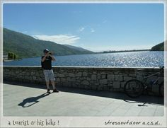 a tourist, his  bike and fotocamera, what else ? :-)