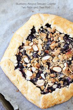Blueberry Almond Streusel Galette Recipe on twopeasandtheirpo. A simple dessert for summer! Easy Desserts, Delicious Desserts, Dessert Recipes, Yummy Food, Tart Recipes, Sweet Recipes, Baking Recipes, Blueberry Galette, Sweet Pie
