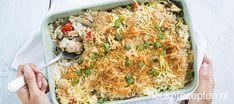 Rijst met kip en champignons in een romige saus met een krokant gegratineerd laagje bovenop