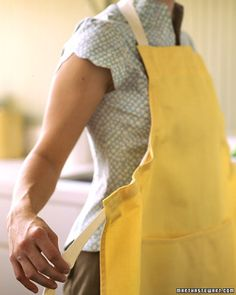 one-size-fits-all apron. It lets you tighten neck and waist strings in a single, fluid motion so the apron can be cinched to fit anyone. via marthastewart
