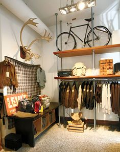 This is a great design for a men's clothing store. Most of the men I know do not shop in overcrowded stores. This store uses open space display small  quantities of what they need. Enough to attract interest, without overwhelming or deterring potential buyers from an unorganized clothing rack.