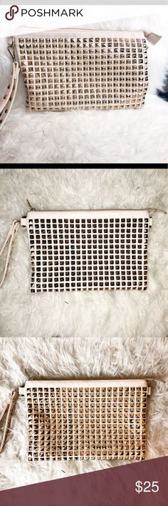 Studded Clutch Studded clutch - amazing size, can fit all your goods! Wear it for a night out, or as an everyday purse since it's such a great size!   Used less than 5 times - excellent condition! Bags Clutches & Wristlets