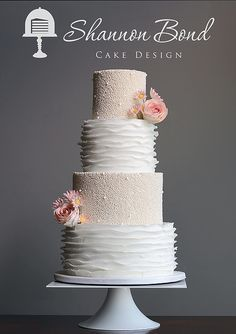 Pearl and Ruffle Wedding Cake. Romantic white wedding cake with gumpaste flowers by Shannon Bond Cake Design. www.sbcakedesign.com