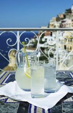 Drinks on balcony of Hotel Le Sirenuse overlooking Positano.