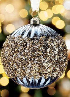A collection that drips with elegance, and looks like it took years to curate. The Gold Rush 60-piece Ornament Collection balances opulent, unexpected details, like globes dipped in sequins or exploding with glittered branches with traditional shapes and matte finishes. Every mouth-blown glass ornament is handpainted and hand-decorated in a rich shade of gold, rose gold, silver, metallic blue or bronze.