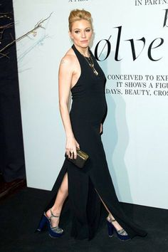 Even pregnant, she's a style star. The dress, heels, hair and gold chains are perfection.