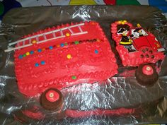 Firetruck cake - used straws to make the ladder. Cupcake wheels.