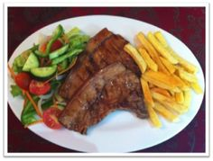 2 grilled pork chops served with golden fries and a fresh green salad on the side - available until 16 Feb 2013 Grilled Pork Chops, Fresh Green, Fries, Steak, Dishes, Food, Plate, Pork Chops On Grill, Essen