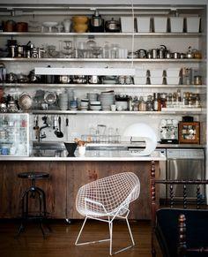 andrea-ferrari-charoonkit-thahong-loft-industrial kitchen stainless steel dark wood bertoia chair