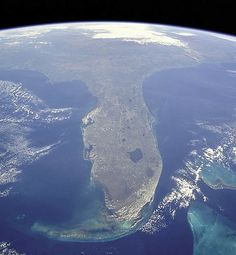 """Florida from space. What does """"Florida"""" mean? Florida was named Pascua Florida by explorer Ponce de Leon on Easter in Translation: means """"Flowery Easter"""" or """"Flowering Easter"""" (after Spain's """"Feast of the Flowers"""" Easter celebration). Florida Girl, Florida Living, Old Florida, State Of Florida, Florida Home, Florida Keys, South Florida, Florida Usa, Florida Travel"""