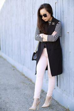 An Dyer wearing Pink James Jeans, Sleeveless vest Coat, Chanel Brooch