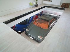 Glass floor looking into garage...hell yeah. Man cave/party room on top.