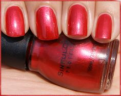 October 2012  Sinful Colors in # 298 Under 18: this pearl Red polish is super cute. It is a bright red with flecks of orange and fire engine red micro glitter - the glitter to polish ratio here is 100:50 and This color does great for sponge art and a thin over coat for deep colors , 1 coat reaches bottle color 2 coats evens it all out. *Photo by Makeup masala.com