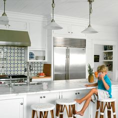 The all-white walls, cabinets, and marble countertops make this space feel clean and sleek. | Coastalliving.com