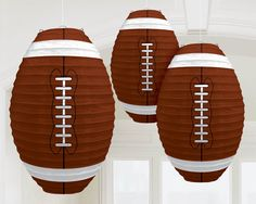 These fun oblong paper lanterns are a great addition to your footballl party. Includes 3 brown colored lanterns with white stitching to look like a football. Easy to assemble and hang. Includes 3 re-u