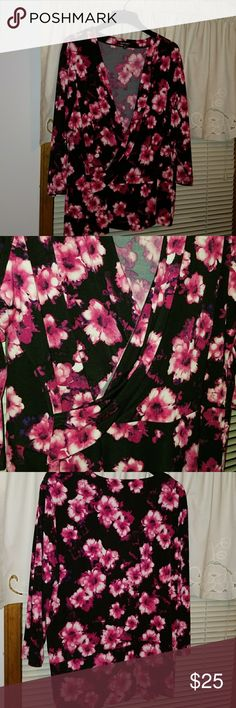 Ellen Tracy Blouse EUC. Only wore one time. Reddish pink and cream flowers on a black background. Surplice neck with 3/4 length sleeves. Very flattering and feels good on. Ellen Tracy Tops Blouses