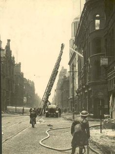 Fire crews in action on Deansgate during the Manchester Blitz of 1940.
