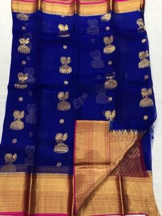 Elegant Fashion Wear Explore the trendy fashion wear by different stores from India Kanchi Organza Sarees, Silk Sarees, Elegant Fashion Wear, Trendy Fashion, Gold Silk Saree, Opposite Colors, Brocade Blouses, Silk Saree Blouse Designs, Stylish Sarees