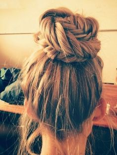Simple high bun with braided fishtail incorporations