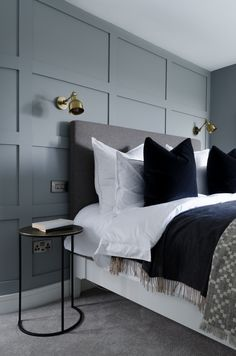 Grey wall panelling in a bedroom with dark charcoal velvet cushions and brass metal accents. Room Ideas Bedroom, Home Decor Bedroom, Light Bedroom, Charcoal Bedroom, Accent Wall Bedroom, Master Bedroom Design, Bedroom Interior Design, Luxurious Bedrooms, My New Room
