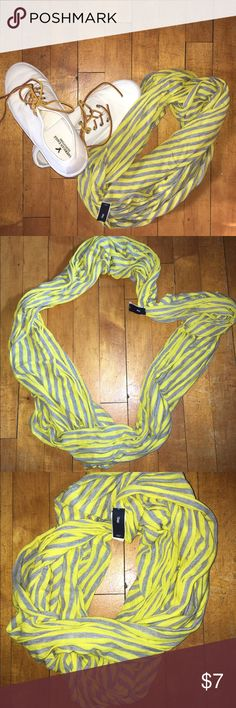GAP Grey and Yellow Strip Infinity Scarf GAP Grey and Yellow Strip Infinity Scarf. Light weight materials. 100% Madal. Perfect Accessory to any spring ☔️outfit or my favorite with a Navy Rain Coat & Hunter Boots GAP Accessories Scarves & Wraps