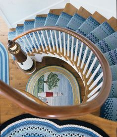 Nautical Entryway with Lighthouse Theme by Diamond Baratta: http://www.completely-coastal.com/2016/06/nautical-lighthouse-newel-post-for-stairway.html