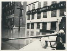 Cincinnati, Ohio, 1937 flood, from the collection of the Klosterman Family: View of Aluminum Industries, Inc., on Beekman Avenue, seen from a rowboat. And the street today, via Google Maps Street View: http://g.co/maps/vm75g