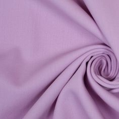 Brighten up your wardrobe with this beautiful, pastel purple, wool fabric from the remarkable designer Oscar de la Renta! Here we have a medium-weight, wool double cloth fabric with a slight give due to the addition of lycra. This material is soft-handed, drapes well for it's thickness, and is completely opaque. Use this gorgeous wool fabric to create uplifting casual apparel as well as cheerful suitings.