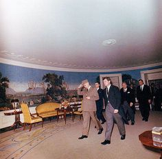 11/25/63: Ted Kennedy walks with General de Gaulle, through the Diplomatic Reception Room, during a reception for world leaders, at the White House, following JFK's funeral.