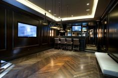 Fantastic basement games room with incredible walnut paneled walls [ Wainscotingamerica.com ] #basement #wainscoting #design