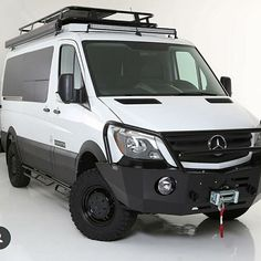 Sprinter Van with Aluminess front winch bumper, nerf bars, and roof rack from Mercedes Sprinter Camper Conversion, Mercedes Sprinter 4x4, Mercedes Benz Vans, Mercedes Van, Sprinter Van Conversion, Camper Van Conversion Diy, Benz Sprinter, Camper Caravan, Truck Camper