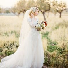 modest wedding dress with long bell sleeves from alta moda bridal (modest boho bridal gowns) photo by ciara richardson