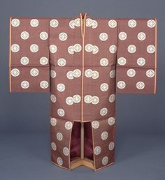 Robe for a Japanese princess. Hosonaga (Princess's Robe) with White Wisteria Medallions on Dark Purple Tortoise-shell. 18th to early 19th century, Japan. Kyoto National Museum