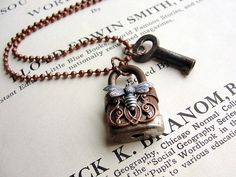 Padlock Key Pendant Necklace Jewelry Steampunk Charm Lock Gypsy Boho Chic.    A vintage padlock adorned with pretty copper filigree and silver bee hangs from a 24 antiqued copper ball chain. Ive added the tiniest little antique skeleton key to the chain. A little rust adds charm to both the lock and key and both have been sealed. The lock measures 1 1/4 tall. An absolutely one-of-a-kind treasure...just for you!  ______________________________________________________________________    TH...