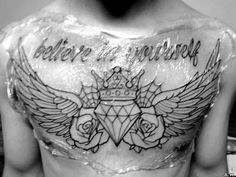 Make that colour, replace the diamond with a realistic heart, and have the memorial above it instead of the saying an I think I have my chestpiece