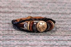 Multi strand flower leather and wood bead by Onlybygracejewelry, $3.00